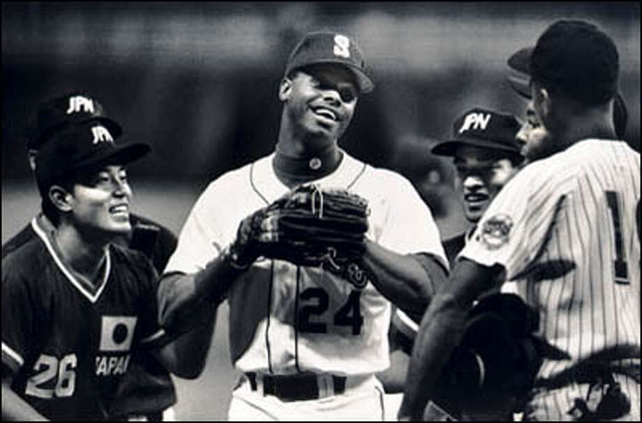 Ken Griffey Jr. holds court with Japanese and Team USA players in the Kingdome prior to Team USA's 4-1 exhibition win between the Olympic entrants. Photo: Seattle Post-Intelligencer