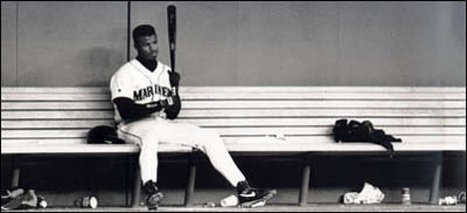 Normally the life of the party, Ken Griffey Jr. spends a few quiet moments alone on the Mariners bench. Photo: Seattle Post-Intelligencer