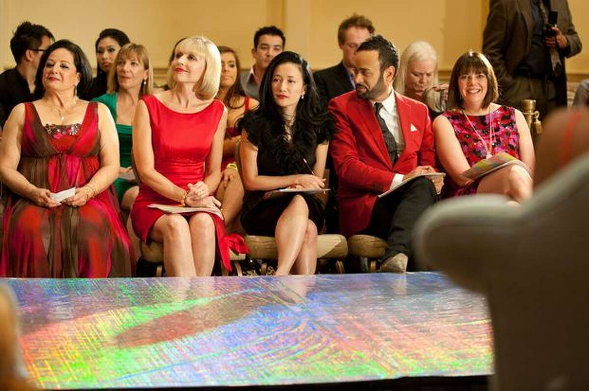 Judges Monir Zandghorieshi, Rose Dennis, Luly Yang, Nick Verreos and Nicole Vogel wait as the third annual Project Red Dress event begins in Fairmont Olympic Hotel.