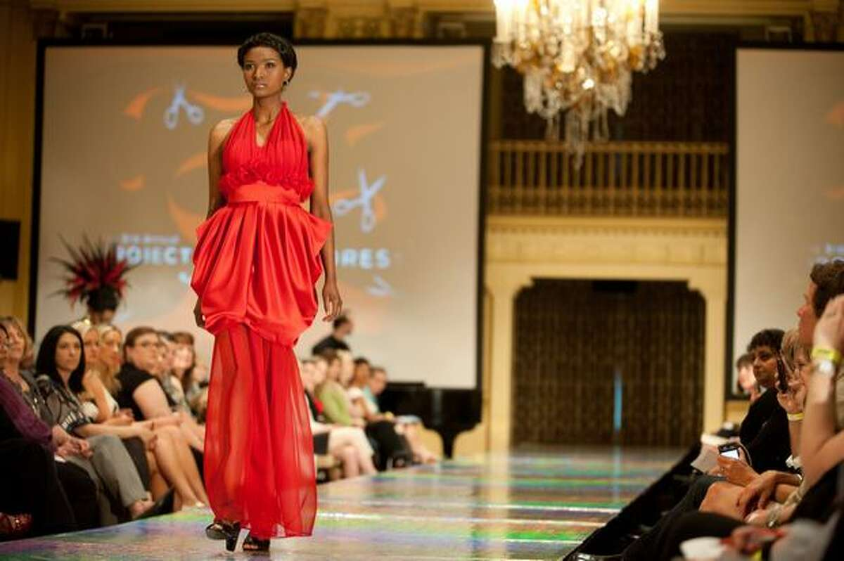 A model wears a dress designed by Jongeun Kim of Seattle Pacific University during the third annual Project Red Dress event in Fairmont Olympic Hotel.