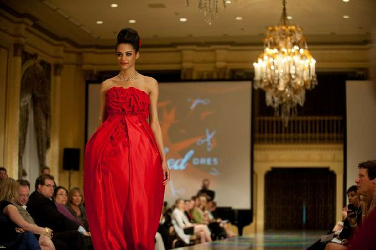 A model wears a dress designed by Molly Griffith of New York Fashion Academy during the third annual Project Red Dress event in Fairmont Olympic Hotel.