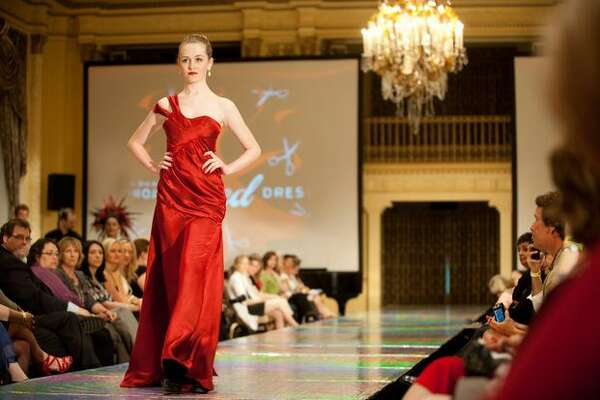 A model wears a dress designed by Justin Bartle of the Seattle Art Institute during the third annual Project Red Dress event in Fairmont Olympic Hotel.