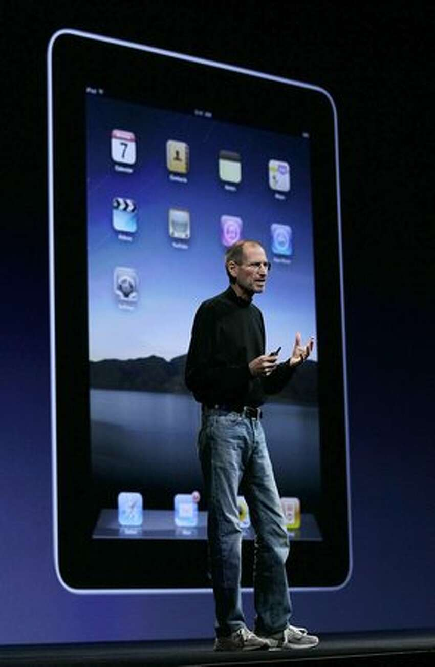 Apple CEO Steve Jobs talks about the iPad before showing the new iPhone during his opening keynote at the 2010 Apple Worldwide Developers conference June 7, 2010, in San Francisco.