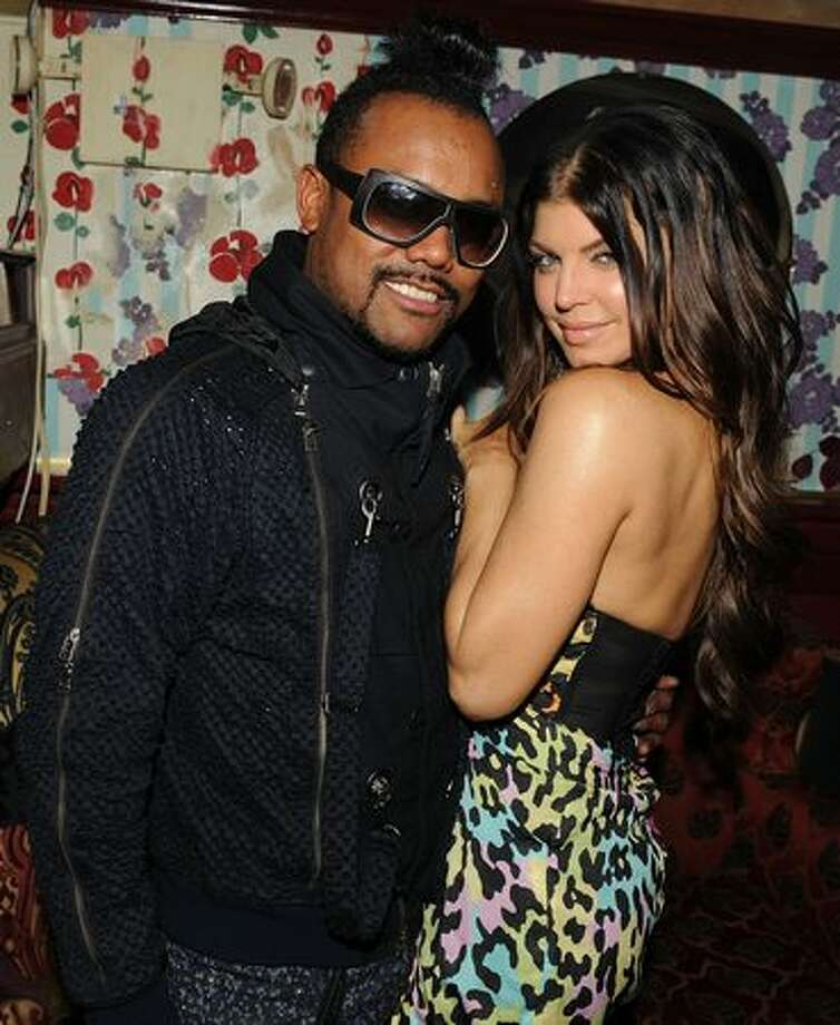 "apl.de.ap and Fergie of The Black Eyed Peas attend The Cinema Society & D&G after party for ""The Twilight Saga: New Moon"" screening in New York. Photo: Getty Images"
