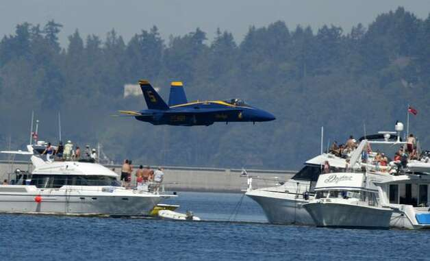 A Blue Angel jet buzzes the boats on Lake Washington in 2006. Photo: P-I File