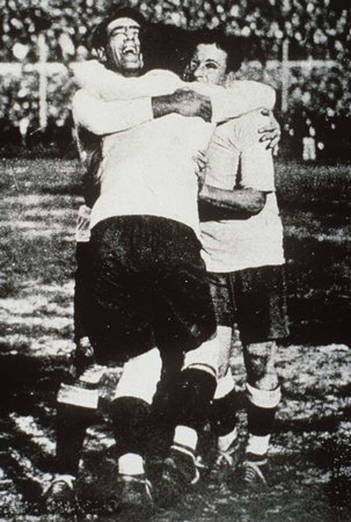 1930: Fernandez, Cea and Scarone of Uruguay celebrate during the final.