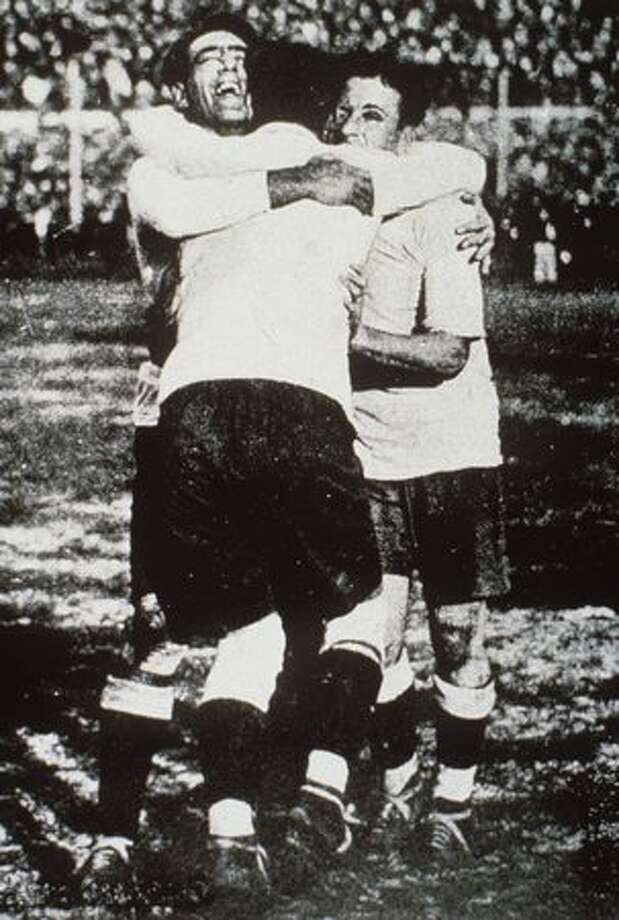 1930: Fernandez, Cea and Scarone of Uruguay celebrate during the final. Photo: Getty Images