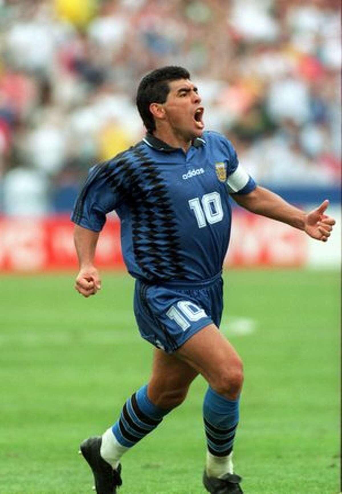 1994: Diego Maradona of Argentina celebrates scoring Argentina's third goal en route to defeating Greece 4-0 Foxboro Stadium in Massachusetts.