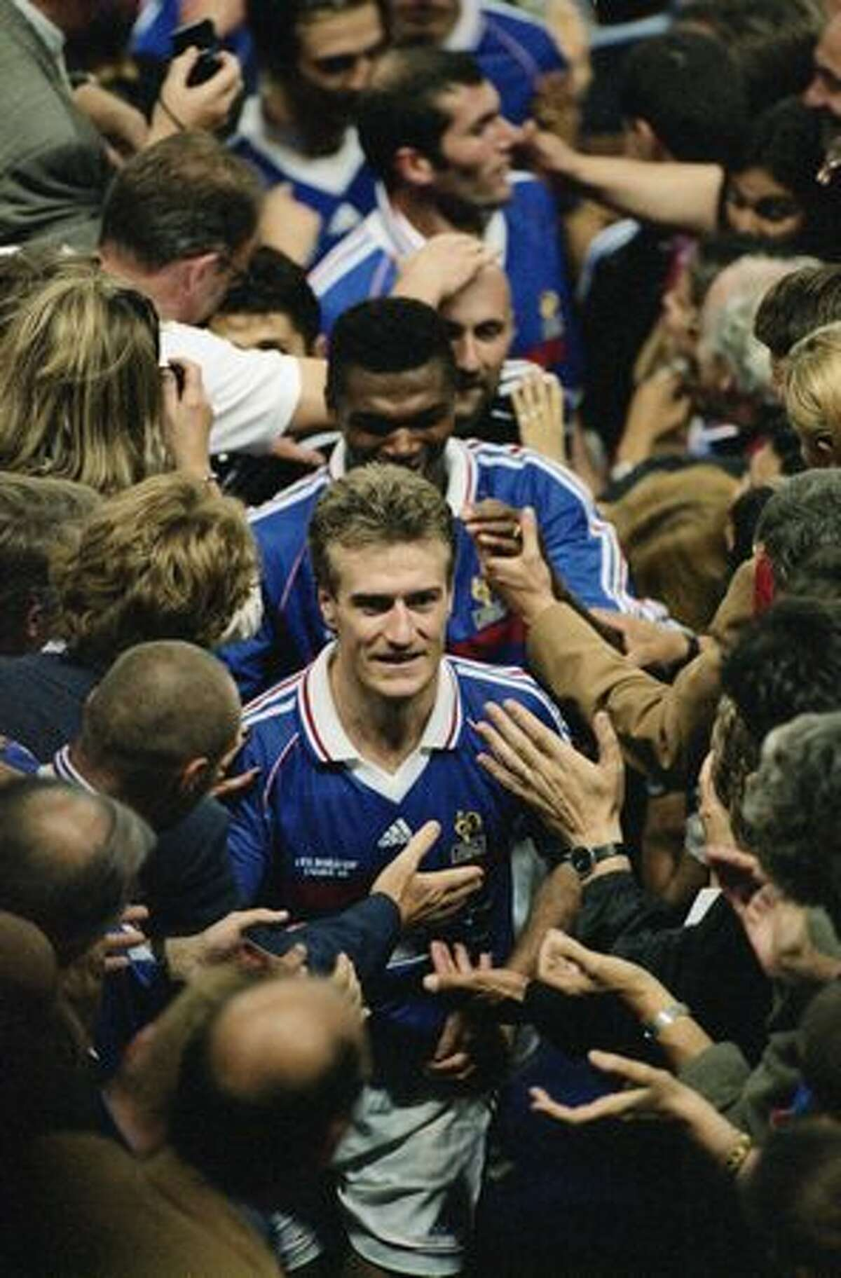 1998: France captain Didier Deschamps leads his team up to the presentation box after victory in the World Cup final against Brazil.