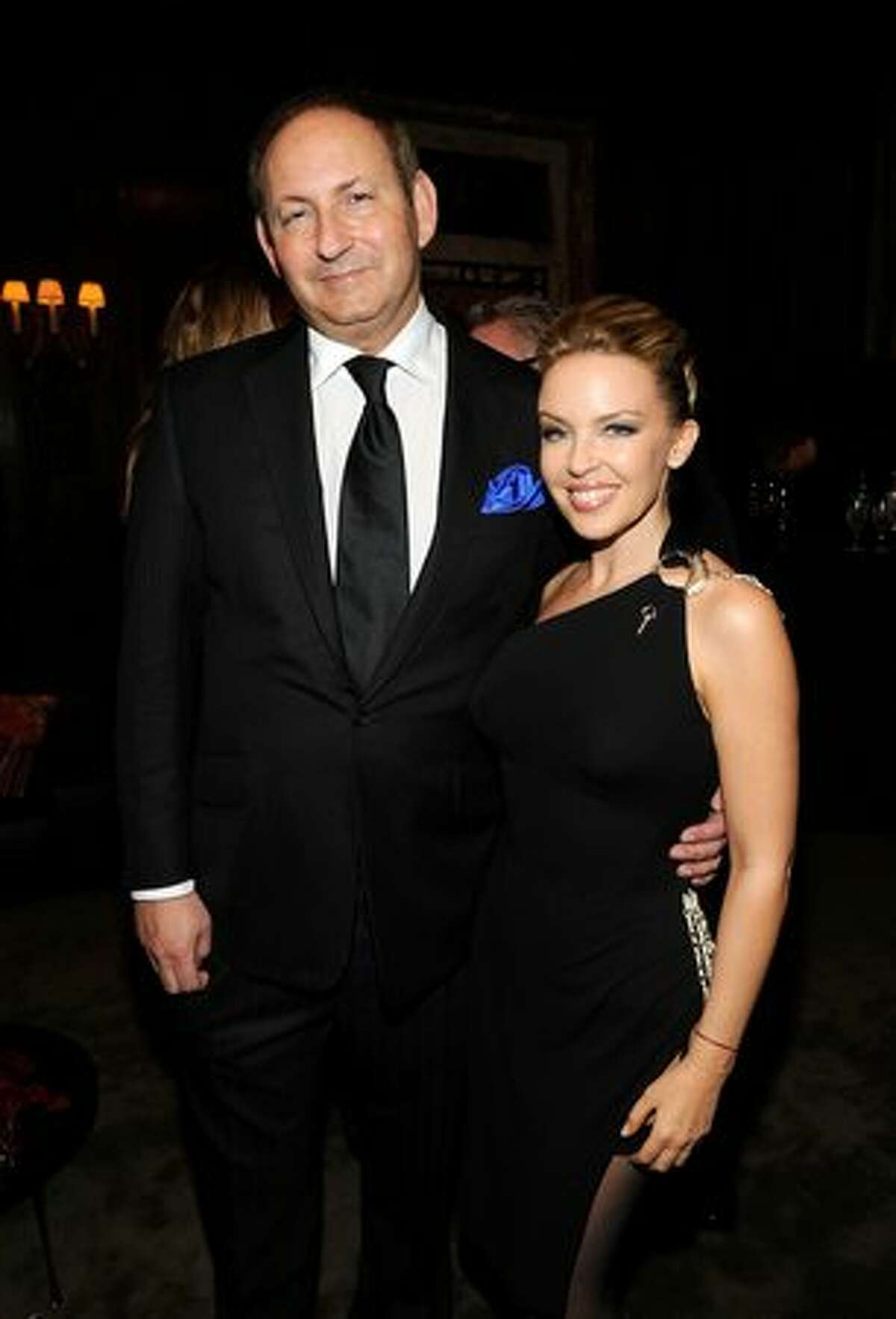 (L-R) President of MAC cosmetics John Dempsey and singer Kylie Minogue attend the 2010 amfAR New York Inspiration Gala at The New York Public Library.