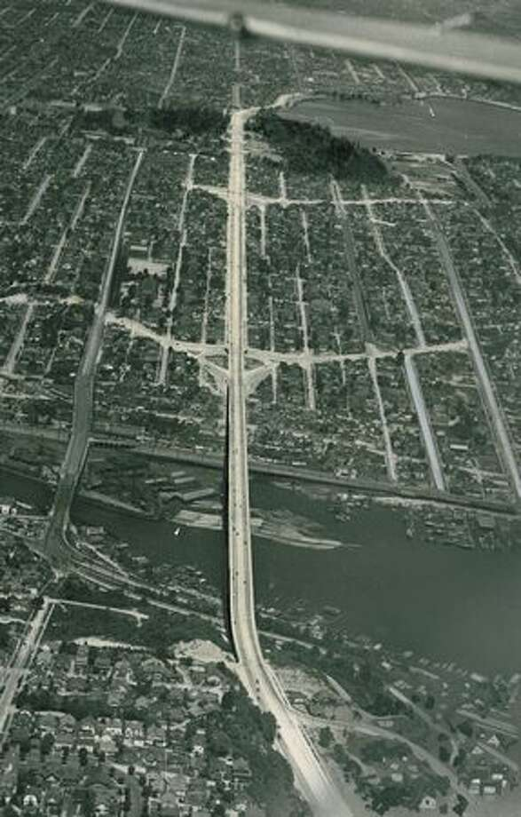 "The original P-I caption from this 1932 photo read: ""The new Pacific Highway as it goes over George Washington Memorial Bridge and out through Woodland Park, skirting Green Lake, showing the big new arterial details connecting with it."" Photo: P-I File"