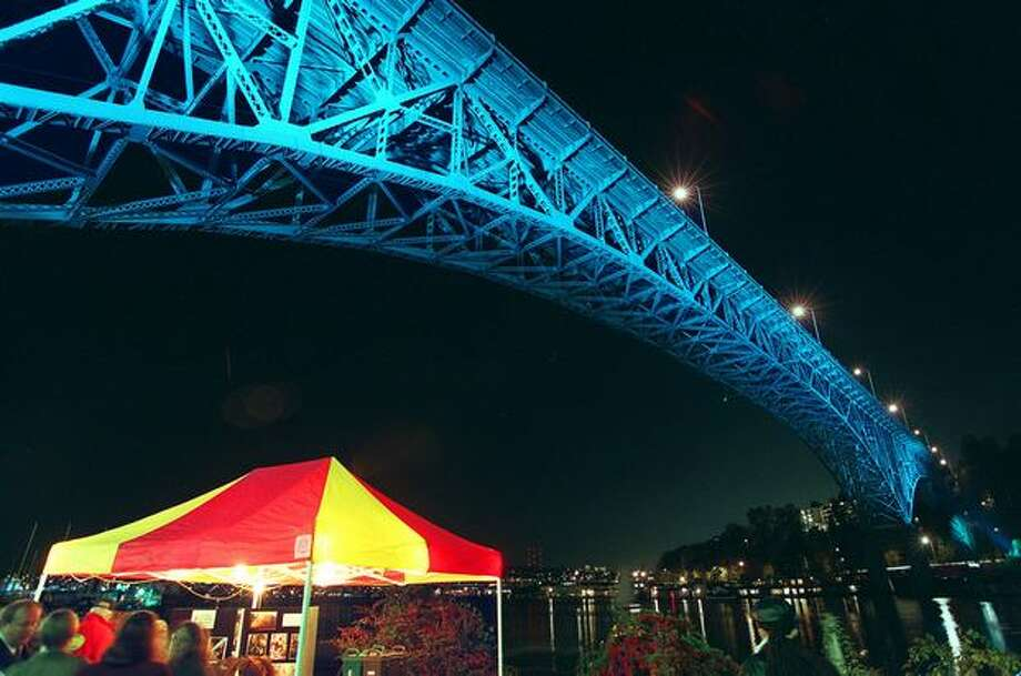The Aurora bridge is test lit with blue lights as part of Seattle's Millennium Legacy Project over the heads of celebrants on the shore of Lake Union on November 18, 1998. (Mike Urban/P-I) Photo: P-I File