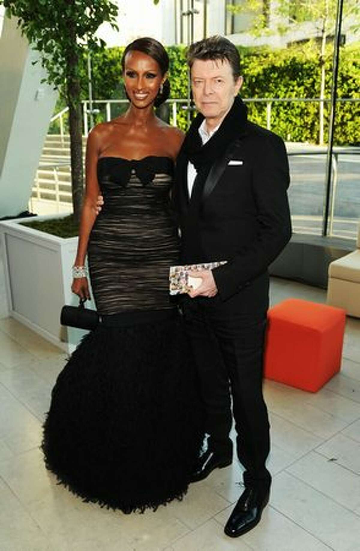 Model Iman (left) and musician David Bowie attend.