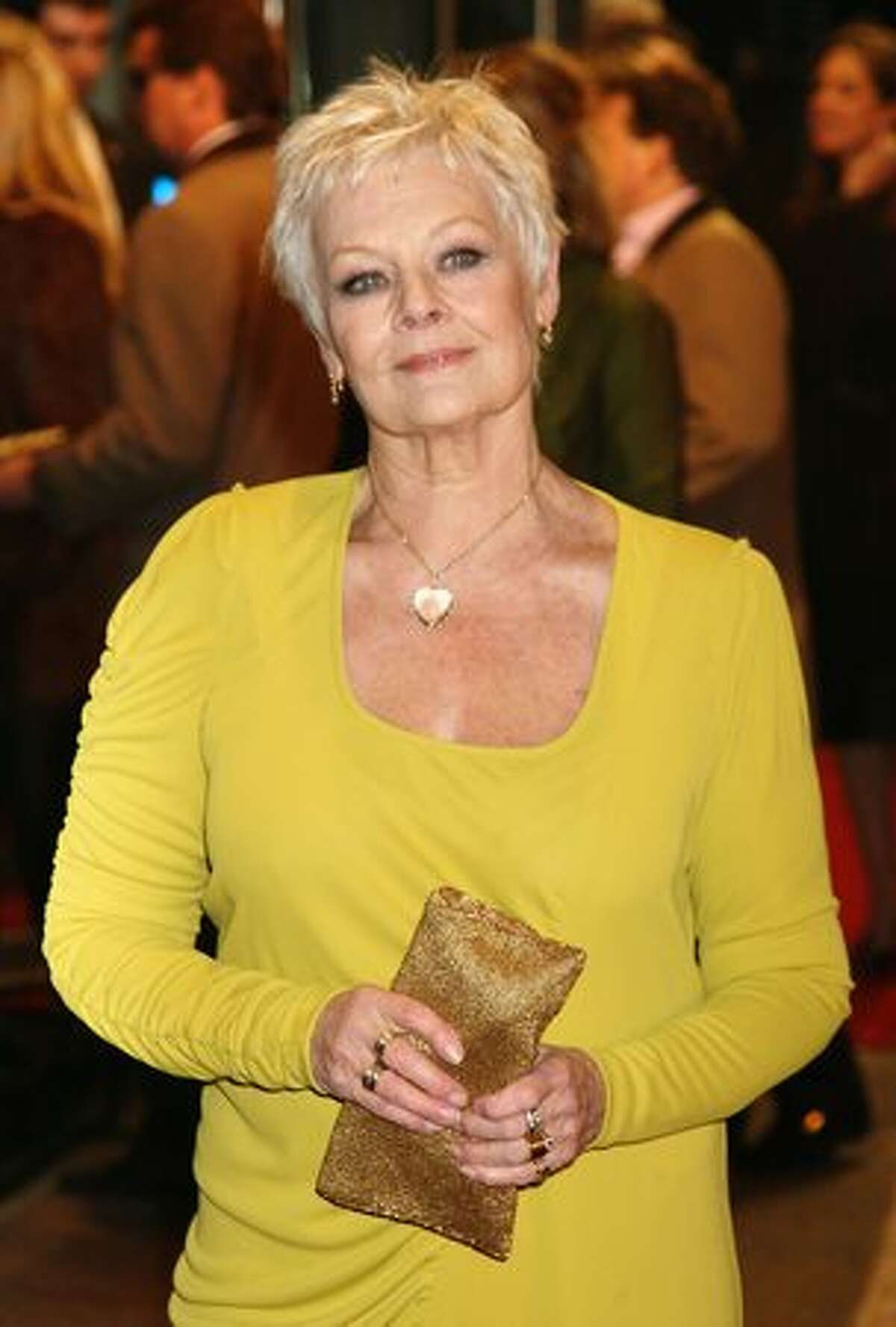 Actress Dame Judi Dench attends the World Premiere of 'Nine.'