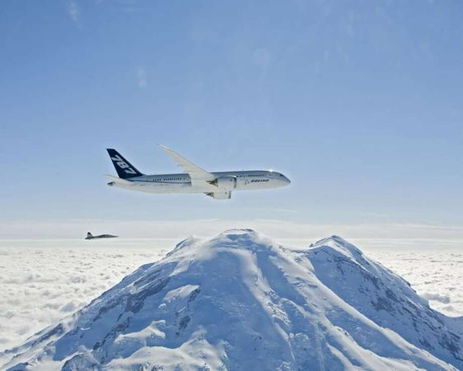 Boeing's fifth 787, ZA005, the first with GEnx engines, passes Mount Rainier with a chase plane during its first flight. Photo: The Boeing Company