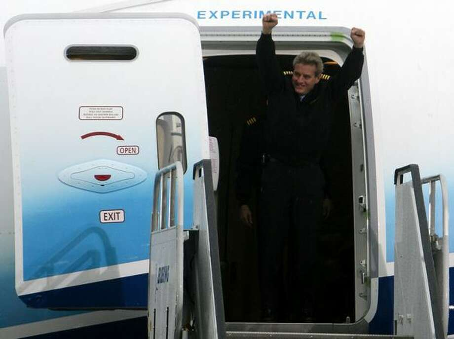 787 Chief Pilot Mike Carriker raises his arms as he departs the 787 Dreamliner after landing at Boeing Field. The plane took off earlier in the day from Paine Field on its maiden voyage. Photo: Aubrey Cohen, Seattlepi.com