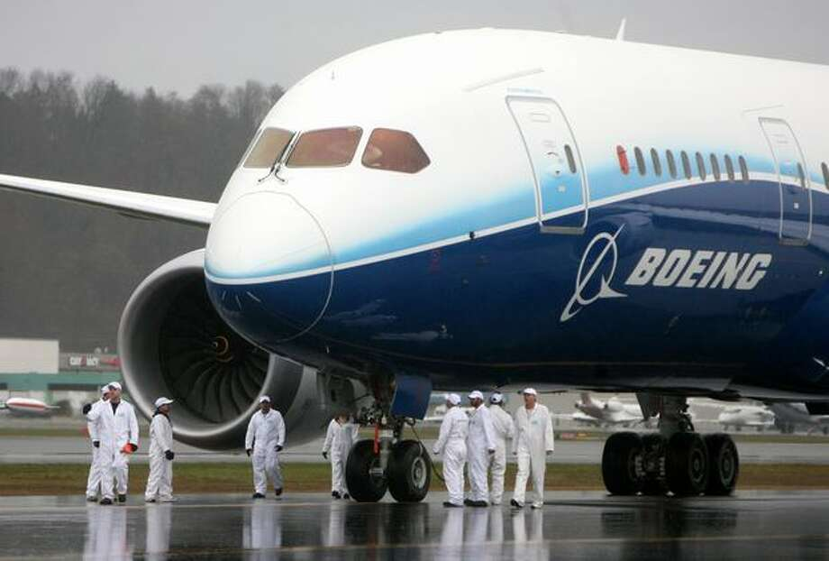 A crew inspects Boeing's 787 Dreamliner after it landed during at Boeing Field. The plane took off earlier in the day from Paine Field on its maiden voyage. Photo: Aubrey Cohen, Seattlepi.com