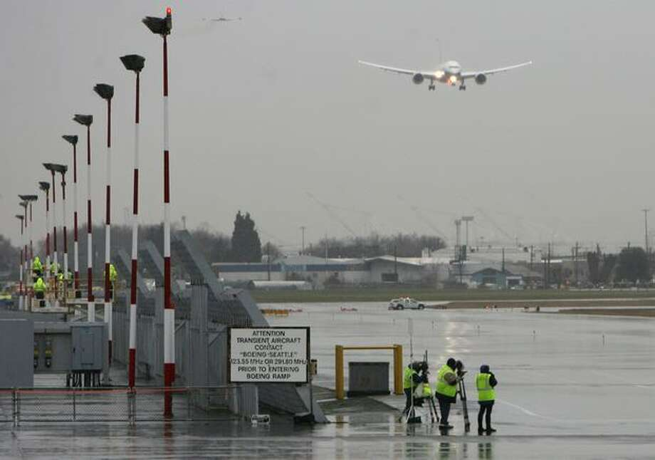 Boeing's 787 Dreamliner approaches Boeing Field as its first flight comes to an end. The plane took off earlier in the day from Paine Field on its maiden voyage. Photo: Aubrey Cohen, Seattlepi.com