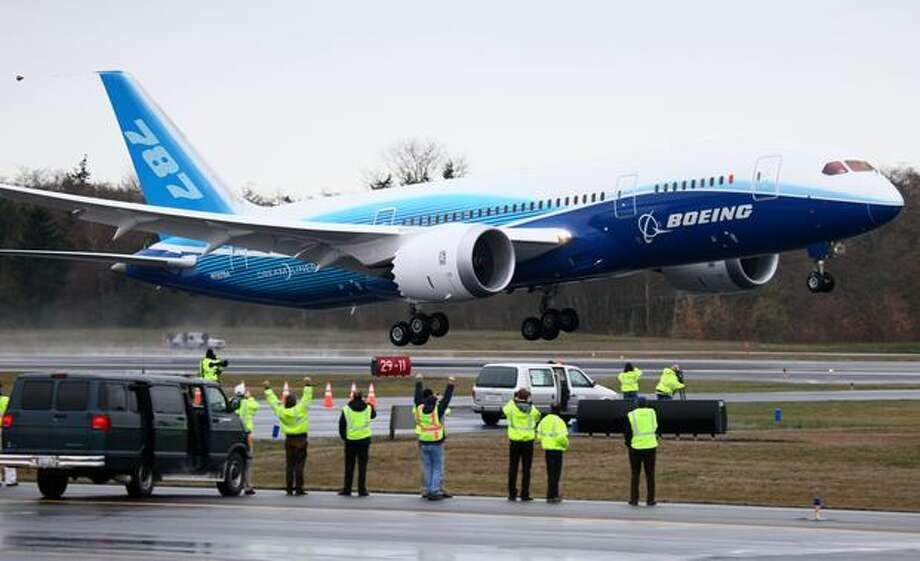 Boeing's 787 flies past excited Boeing workers on Tuesday morning from Paine Field in Everett. Photo: Joshua Trujillo, Seattlepi.com