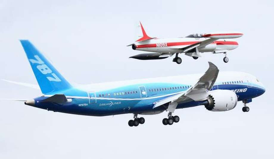 Boeing's 787 takes off with a T-33 chase plane following close behind on Tuesday. Photo: Joshua Trujillo, Seattlepi.com