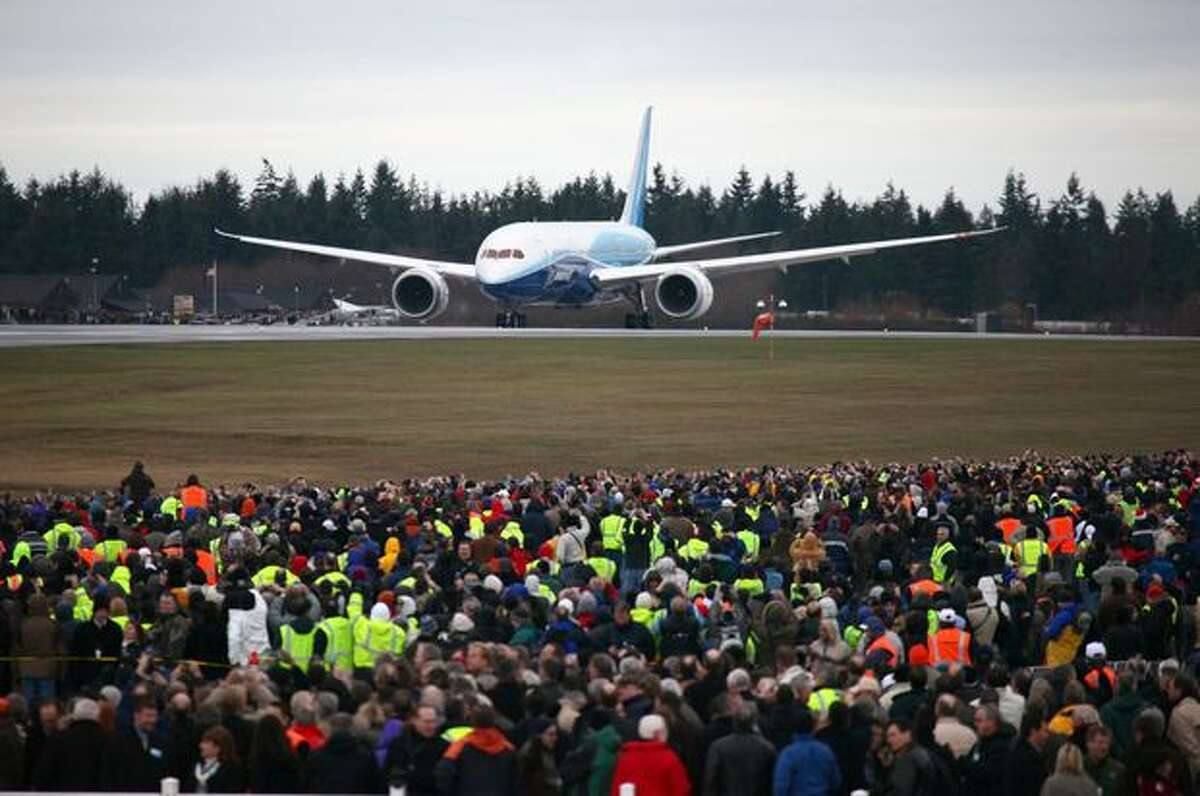 Boeing's 787 Dreamliner taxis down the runway before taking off on its maiden flight.