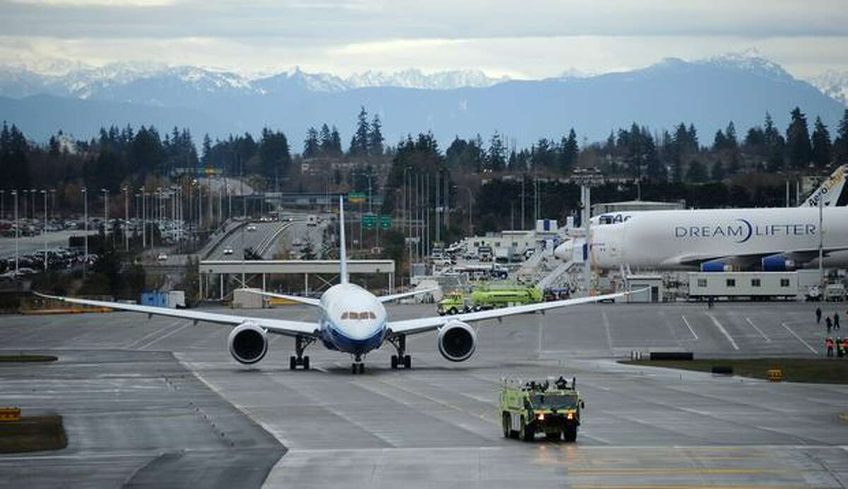 Boeing's 787 Dreamliner makes its way to the runway for its first flight at Paine Field in Everett.