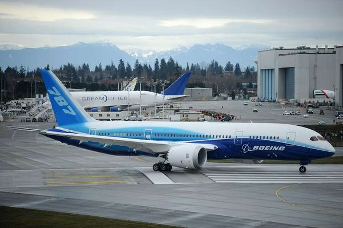 Boeing's 787 Dreamliner taxis down the runway to make its first flight at Paine Field in Everett.