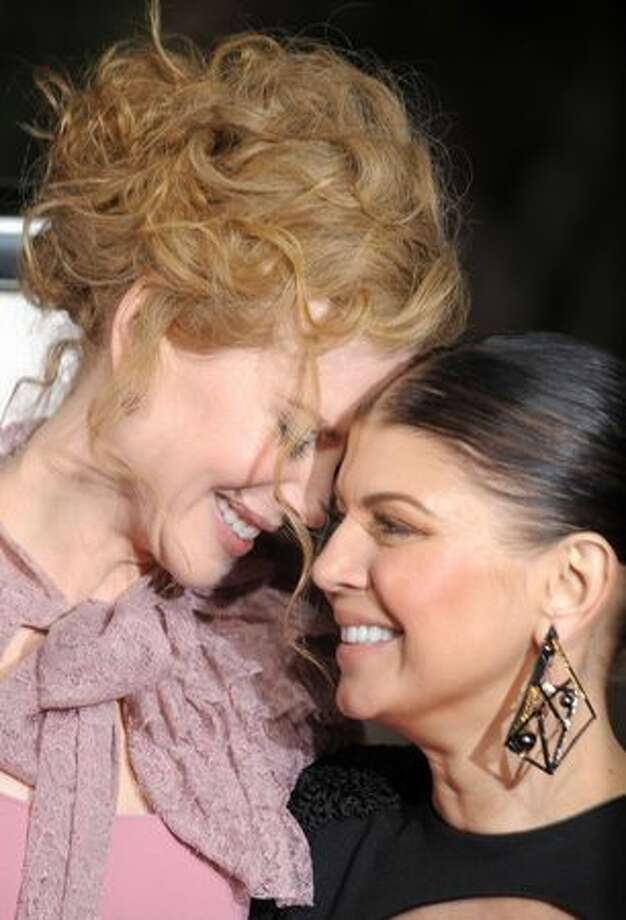 "Actresses Nicole Kidman (L) and Stacy ""Fergie"" Ferguson arrive at the Los Angeles premiere of ""Nine"" at the Mann Village Theatre in Westwood, Calif., on Wednesday, Dec. 9, 2009. Photo: Getty Images"