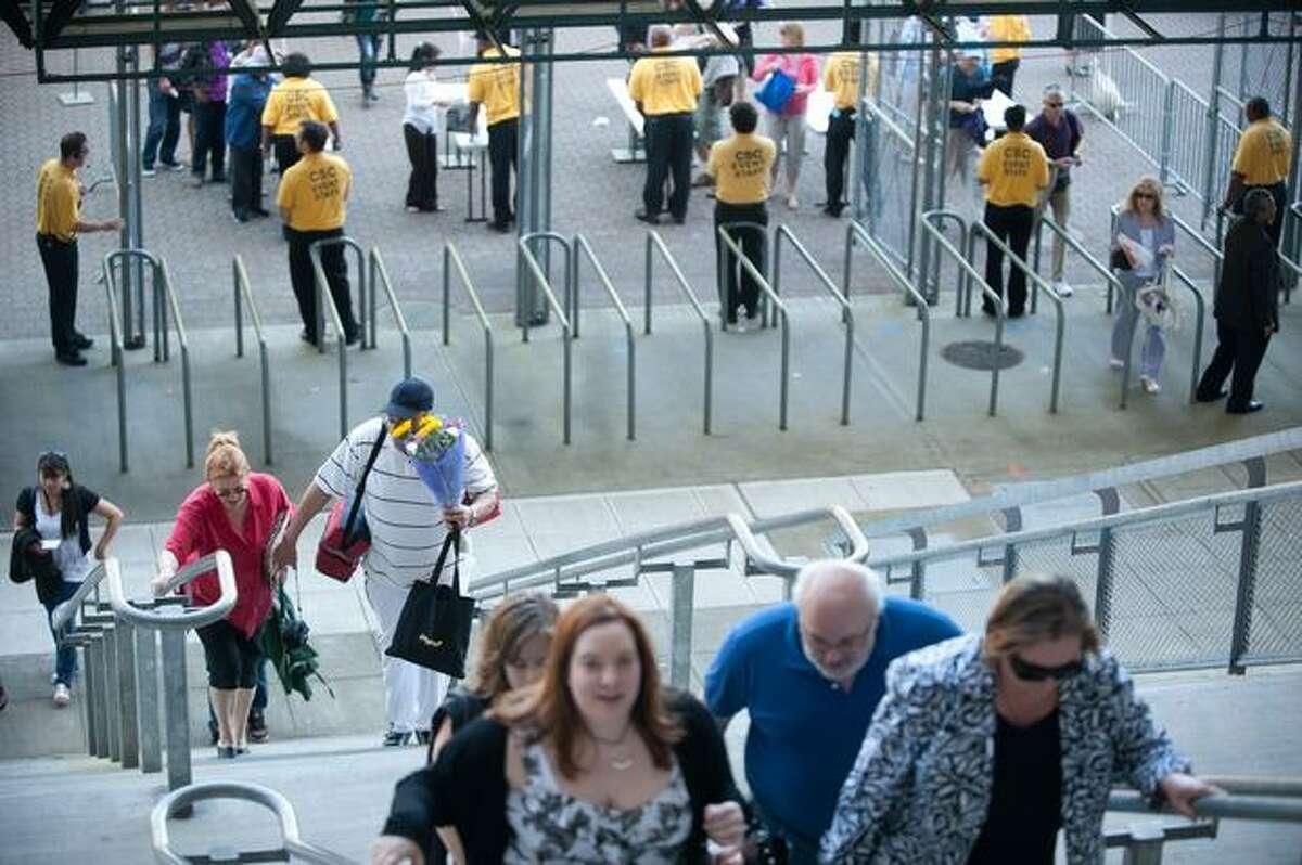 Parents walk into Husky Stadium for University of Washington graduation ceremonies on Saturday, June 12, 2010.