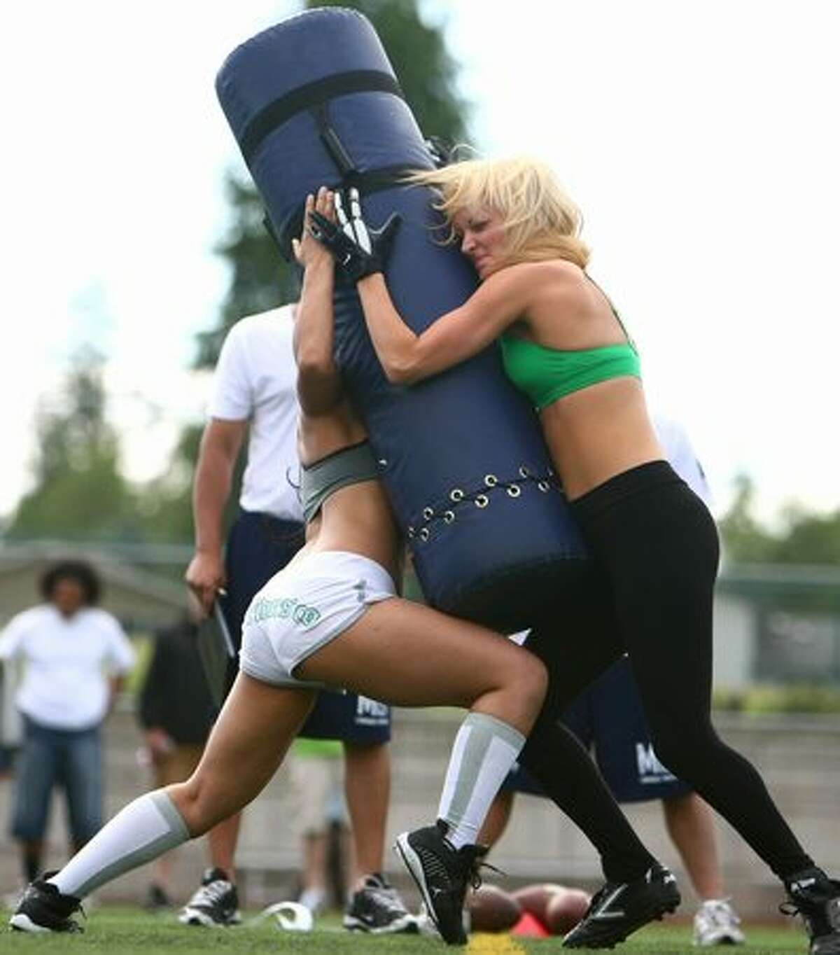 Women battle during drills.