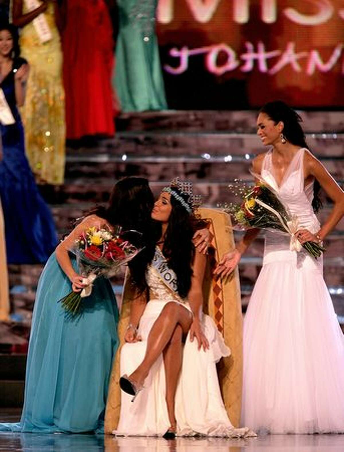 Miss Gibraltar is crowned Miss World 2009 with runner up Miss Mexico Perla Beltran Acosta (L) and 3rd place finisher Miss South Africa Tatum Keshwar (R) at Gallagher Convention Center in Johannesburg, South Africa.