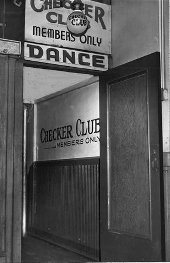 The popular Checker Club was closed in 1945 by Sheriff Harlan S. Callahan. The club was at 1115 1/2 First Avenue. Photo: P-I File