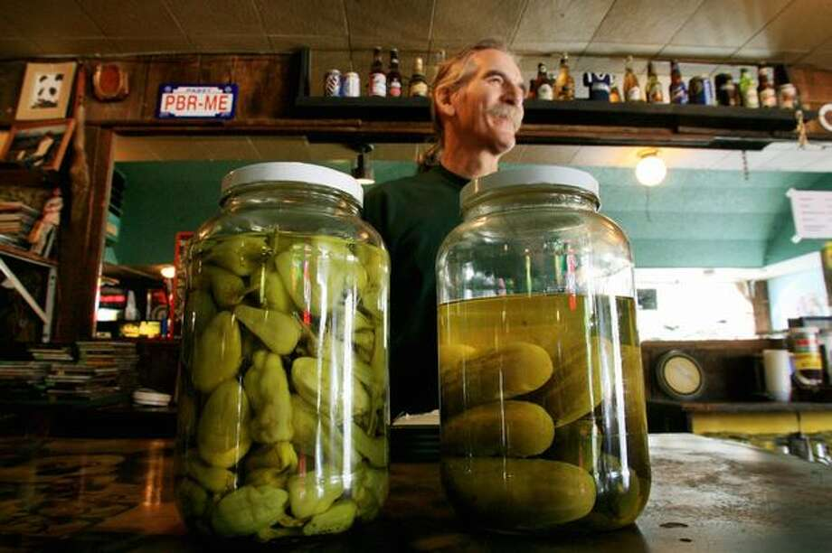 Howard Brown, 59, talks to a customer while tending bar at the Eastlake Zoo Tavern on Sunday, September 23, 2007. Brown first worked in the Zoo, a co-op tavern, from 1978 to 1992. (Dan DeLong photo) Photo: P-I File