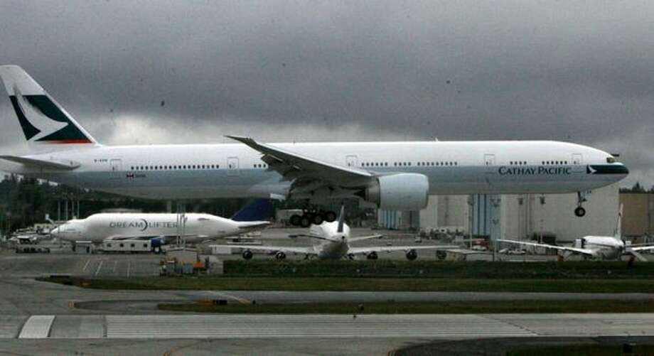 A Cathay Pacific Boeing 777 lands at Paine Field, in Everett. Photo: Aubrey Cohen, Seattlepi.com