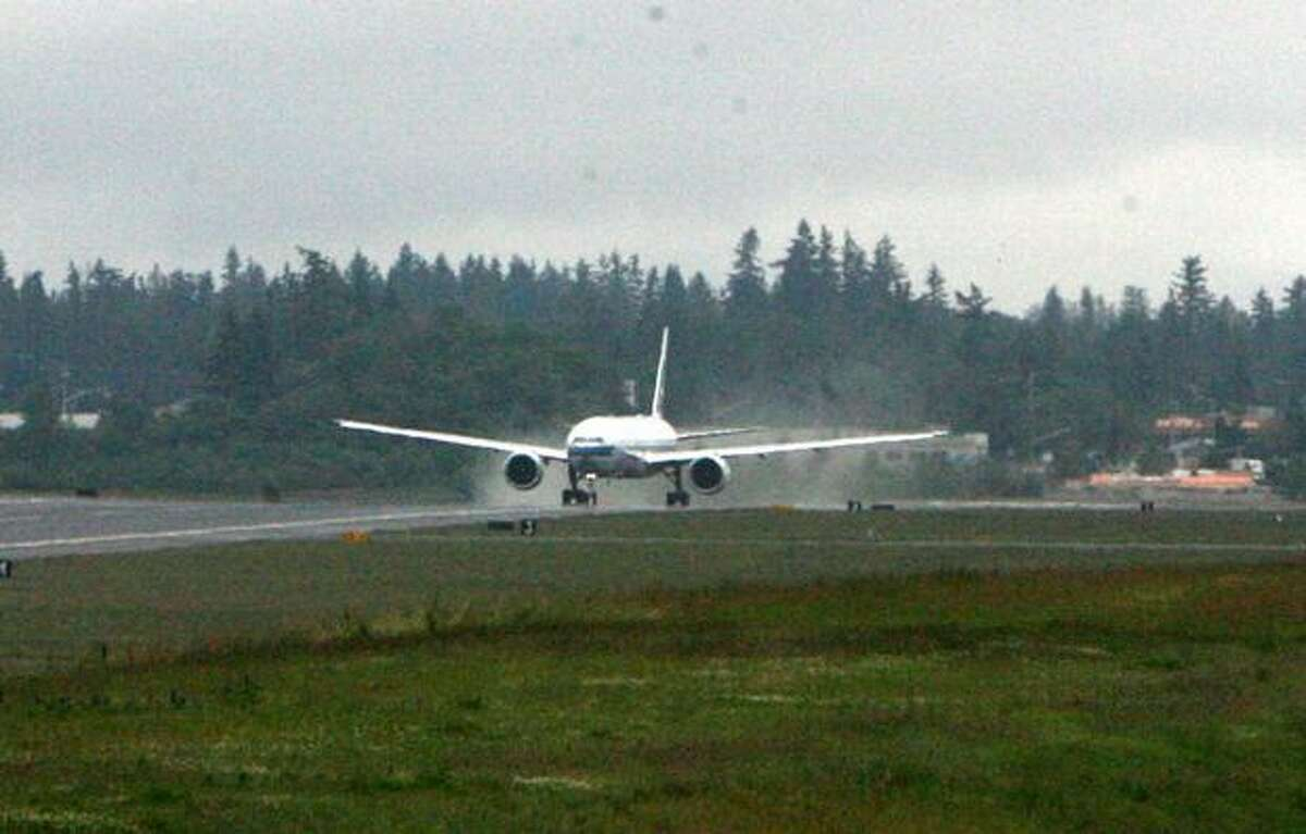 A Cathay Pacific Boeing 777 test its brakes at Paine Field, in Everett.