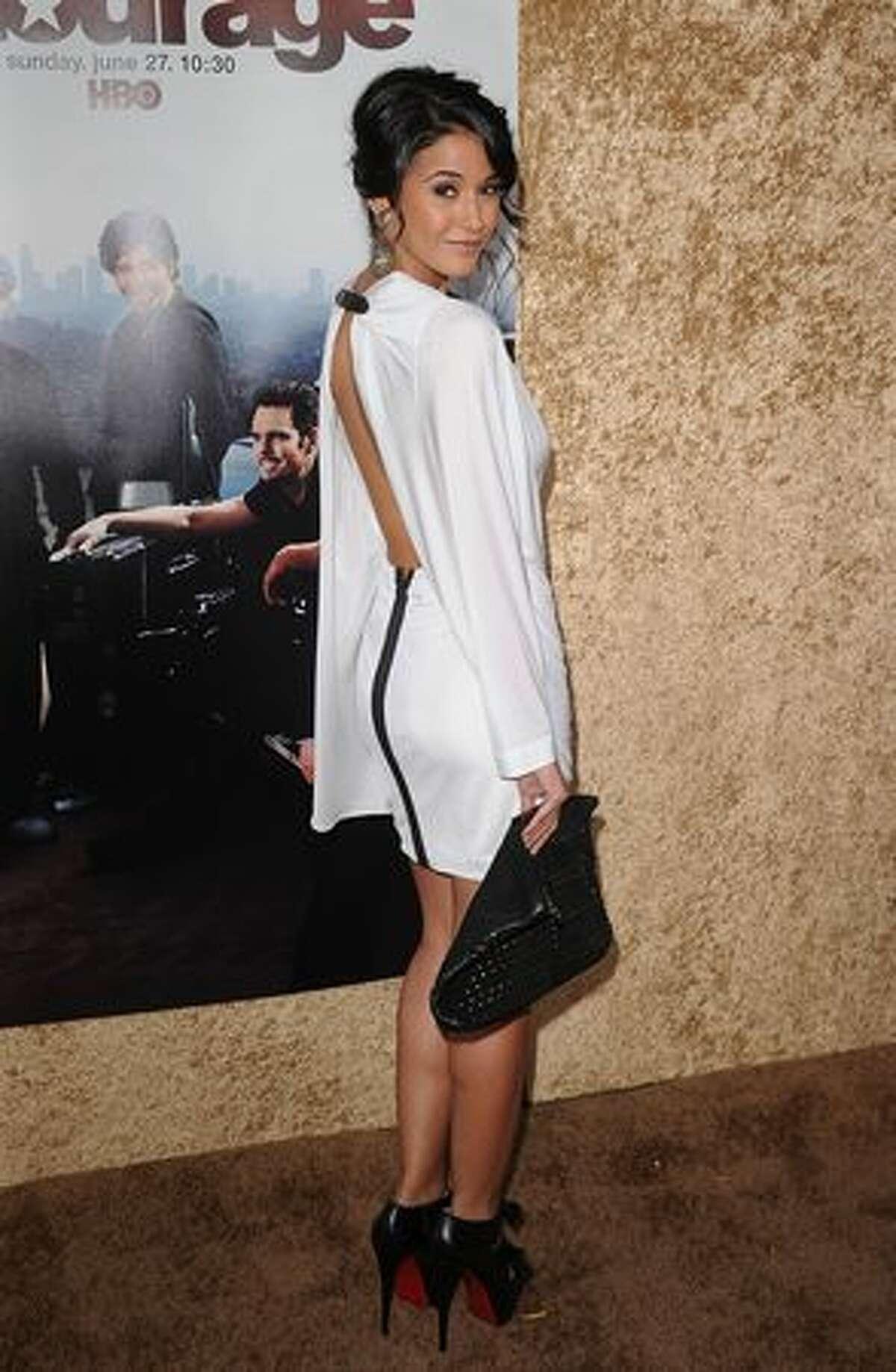 Actress Emmanuelle Chriqui arrives at HBO's