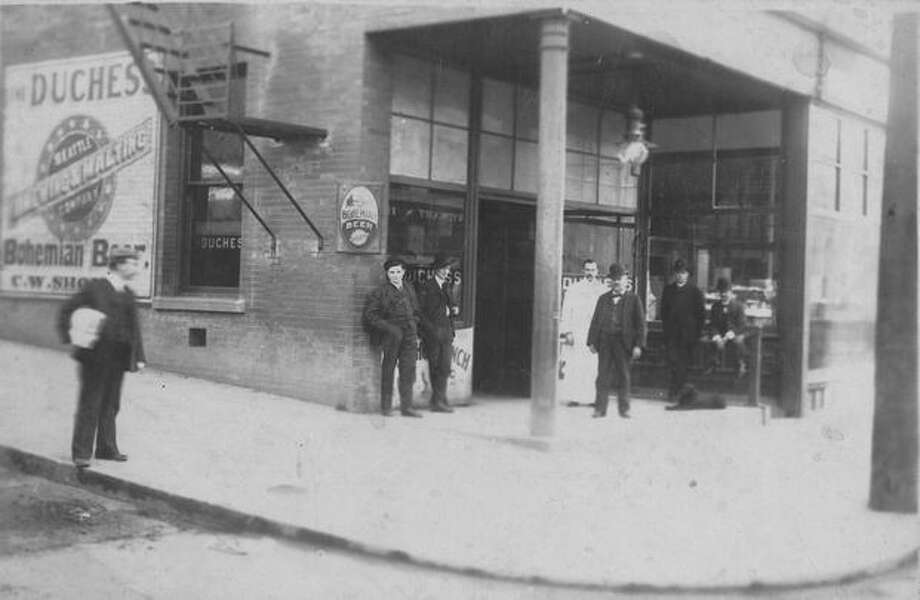 A crowd of men sit out outside Seattle's first Duchess Saloon in 1904. Photo: P-I File
