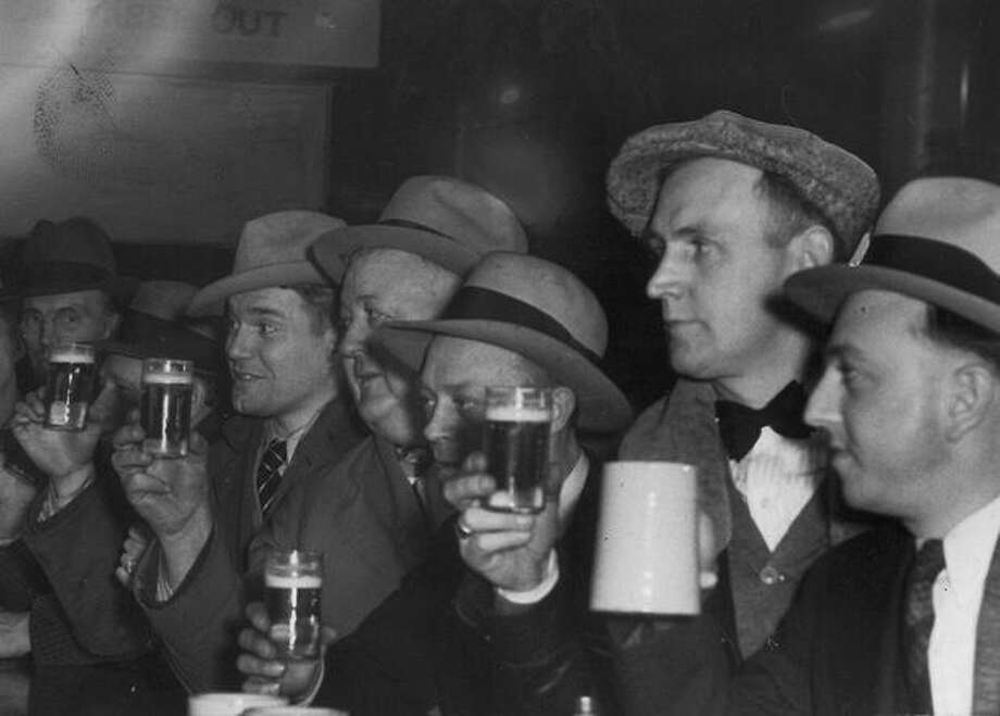 A group of men drinking at Saloon 5, 1932. Photo: P-I File