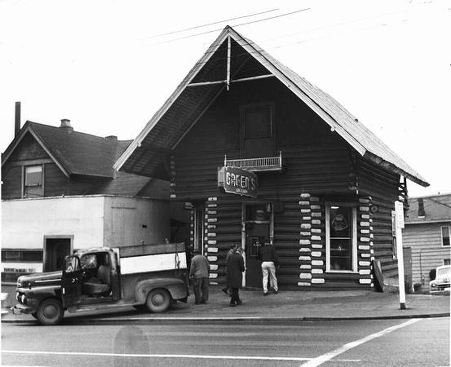 Greens Log Cabin Tavern was at Queen Anne Avenue North and Republican Street. It moved in 1966 when a pancake restaurant took its place. Photo: P-I File