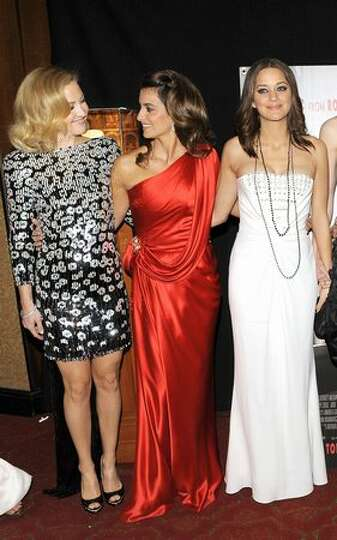 From left, actresses Kate Hudson, Penelope Cruz and Marion Cotillard attend.