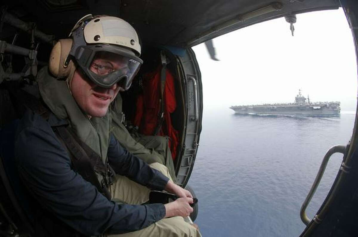 German Defense Minister Karl-Theodor zu Guttenberg looks at the aircraft carrier USS Harry S. Truman from a helicopter at an undisclosed position in the Mediterranean Sea, south of Sicily.
