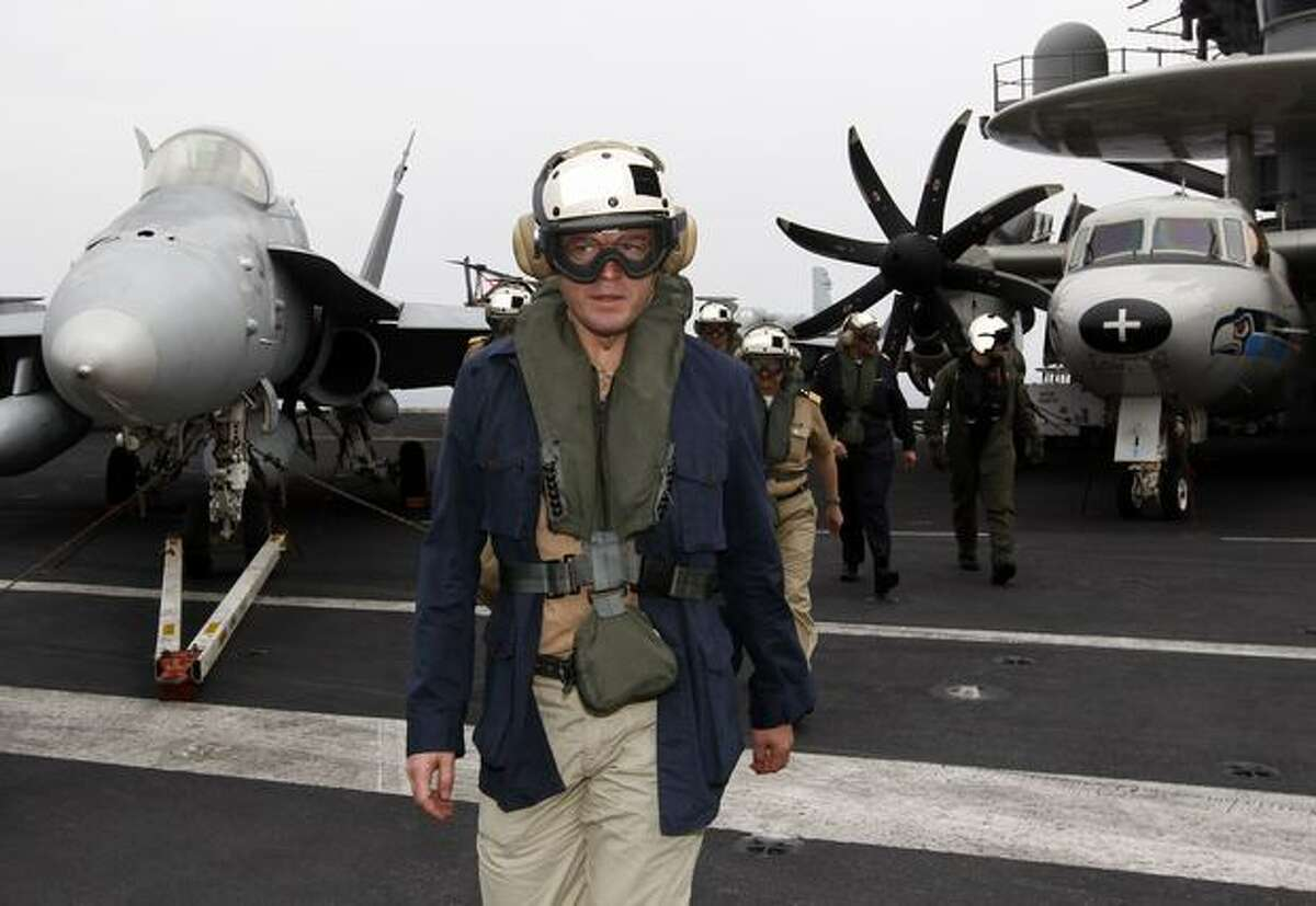 German Defense Minister Karl-Theodor zu Guttenberg walks on the aircraft carrier USS Harry S. Truman at an undisclosed position in the Mediterranean Sea, south of Sicily.
