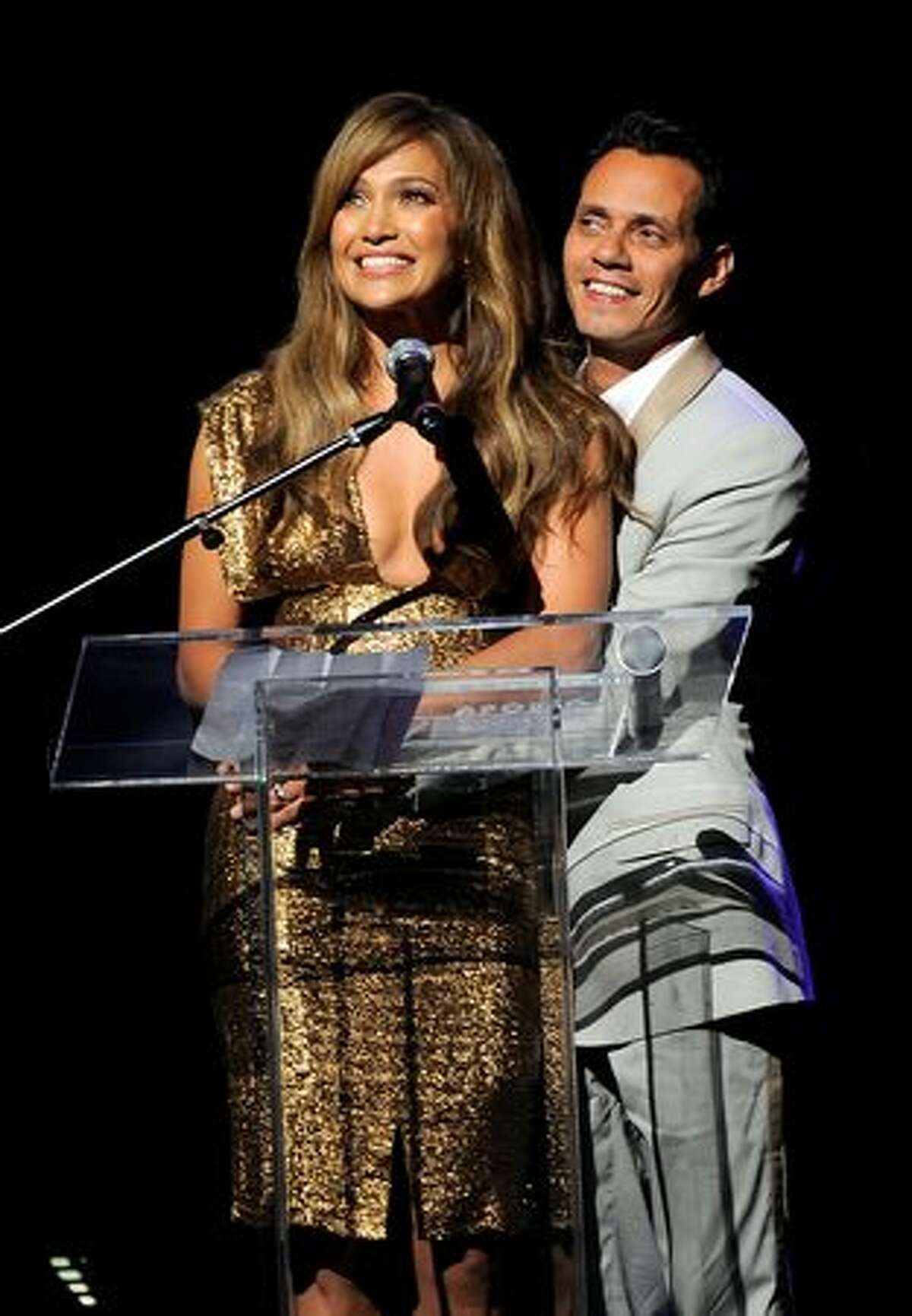 Singer\actress Jennifer Lopez and singer Marc Anthony accept the Ruby Dee & Ossie Davis Arts and Humanitarian Award during the 2010 Apollo Theater Spring Benefit Concert & Awards Ceremony at The Apollo Theater.