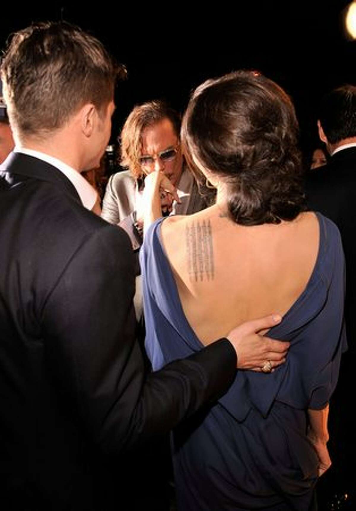 From left, actors Brad Pitt, Mickey Rourke and Angelina Jolie in the audience at the 15th annual Screen Actors Guild Awards held at the Shrine Auditorium on Jan. 25 in Los Angeles.