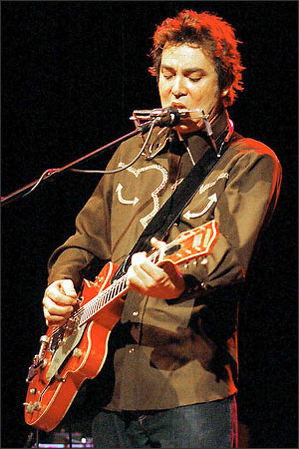 Lucinda Williams' guitarist, Doug Pettibone. Photo: Paul Joseph Brown, Seattle Post-Intelligencer