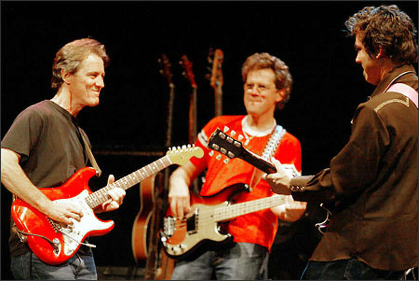 Lucinda Williams' bassist, Taras Prodaniuk, and guitarist Doug Pettibone were joined for their concert at The Moore by long-time friend and colleague, pedal steel guitarist Greg Leisz. Leisz, at left, was in Seattle weekend to perform with Bill Frisell and The Intercontinentals at an Earshot Jazz concert at On The Boards.