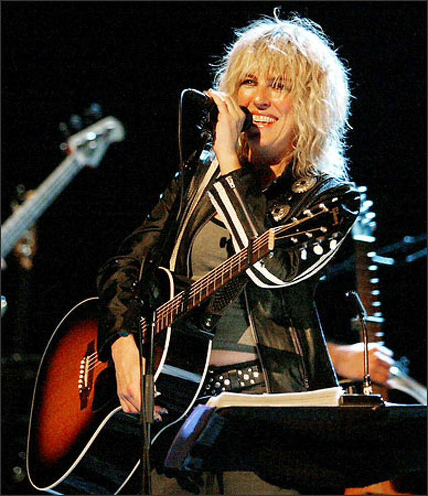 Lucinda Williams invited the audience at The Moore to come down to the stage and dance, and when they did, she said,