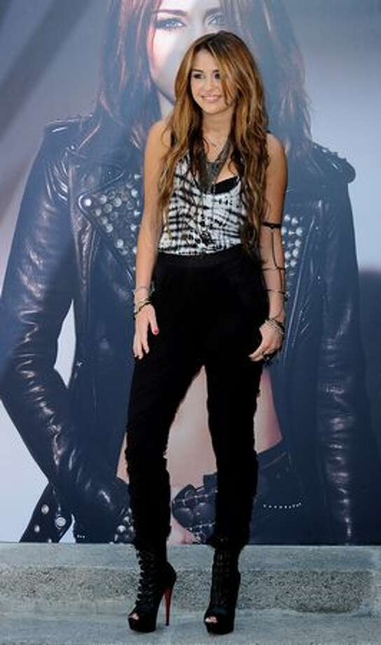 """In this gallery, we'll take a look at how Cyrus has presented herself in public since October 2008, when she celebrated her forthcoming 16th birthday with a performance at Disneyland. Here, she promotes her new album """"Can't Be Tamed"""" in Madrid on May 31. Photo: Getty Images"""