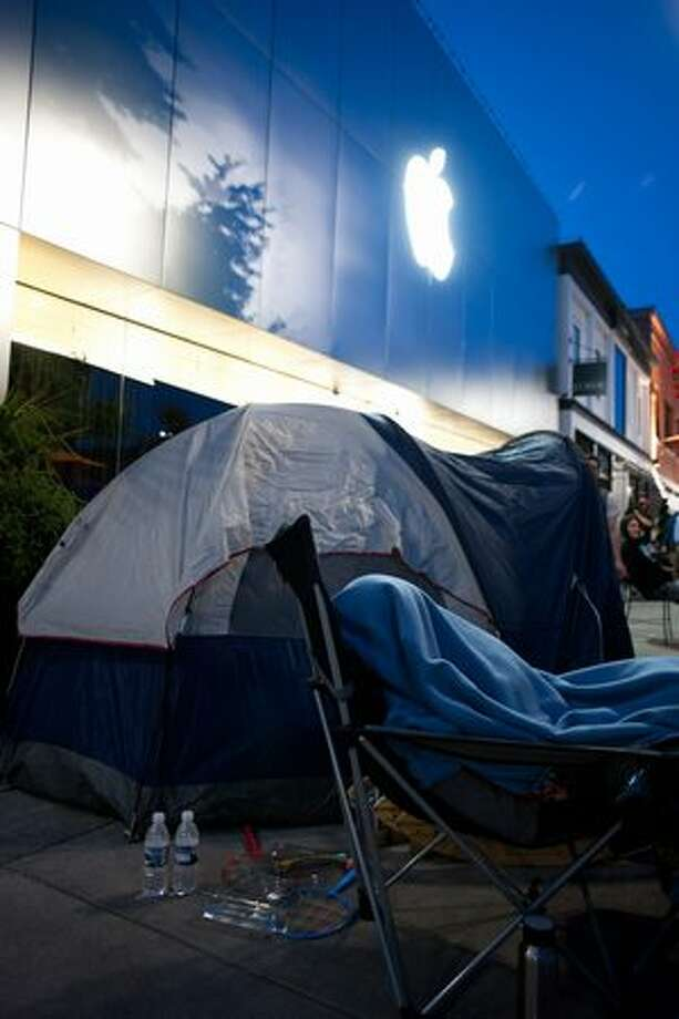 The scene outside of the Apple store in University Village looked more like a campsite than a shopping center as consumers waited for doors to open Thursday. Photo: Elliot Suhr, Seattlepi.com