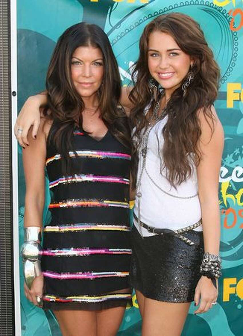 Singer/actress Fergie and Cyrus arrive at the 2009 Teen Choice Awards held at Gibson Amphitheatre in Universal City, Calif., on August 9, 2009.